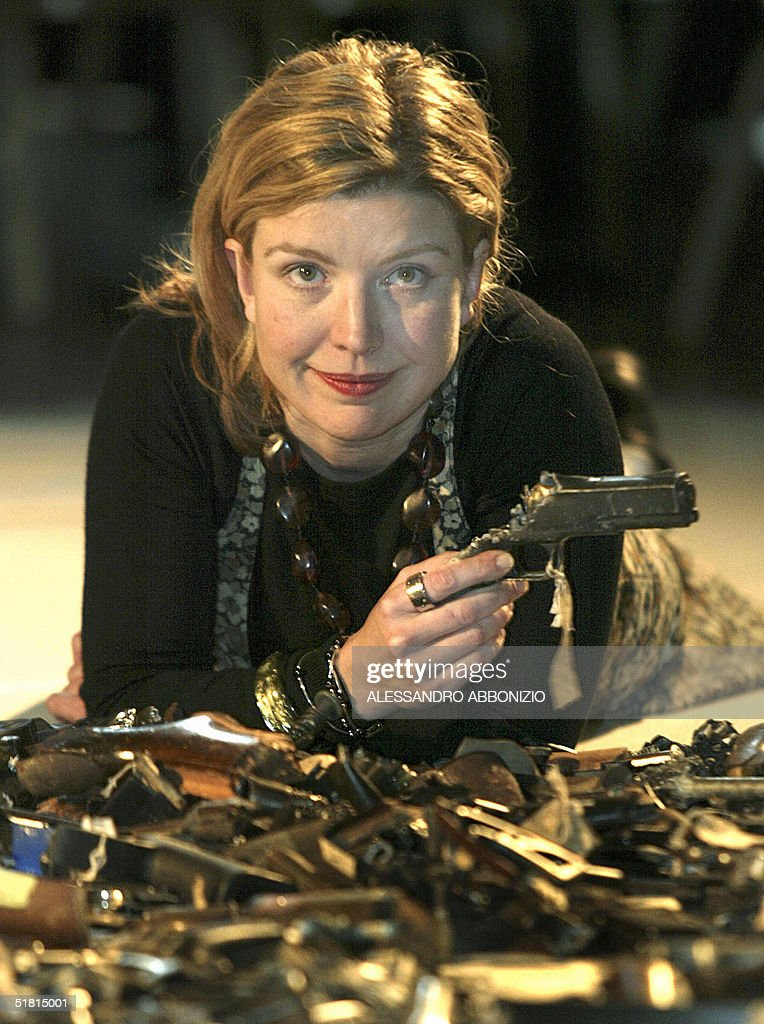 British artist Lucy Wood unveils her latest artwork 'Map 272183' at the Metropolitan Police Gun Crime Conference in London 02 December, 2004. The artwork measures 8 by 6.26 metres and is made up of a sizeable portion of the three thousand and eighty five weapons that were handed in under the Gun Amnesty of 2003.