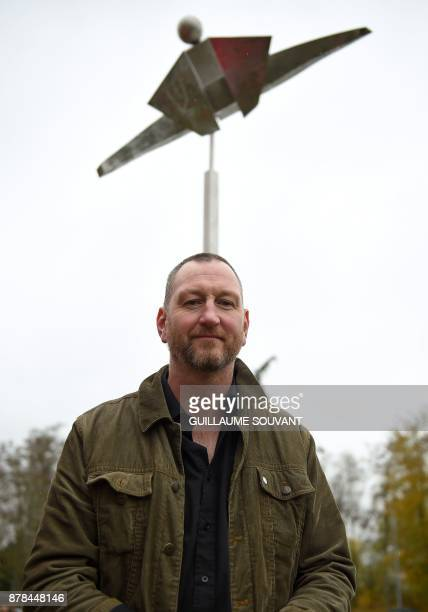 British artist Matthew Ellis poses in front of his sculpture entitled 'Le Clitoris' on November 24 2017 at Poitiers's University / AFP PHOTO /...