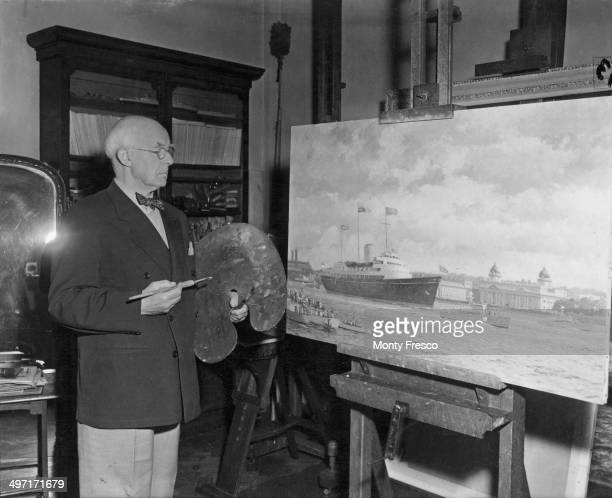 British artist Norman Wilkinson in his north London studio with his painting of the Royal Yacht Britannia 7th July 1954