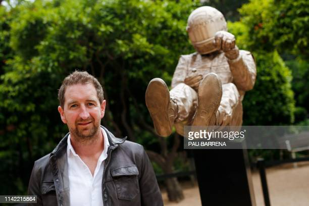 British artist Paul Oz stands next to his bronze statue depicting late Brazilian Formula One driver Ayrton Senna during a ceremony in Barcelona on...