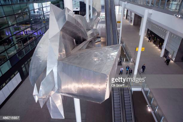British artist Richard Wilson's new artwork 'Slipstream' is displayed in Terminal 2 of Heathrow airport on April 23 2014 in London England The...