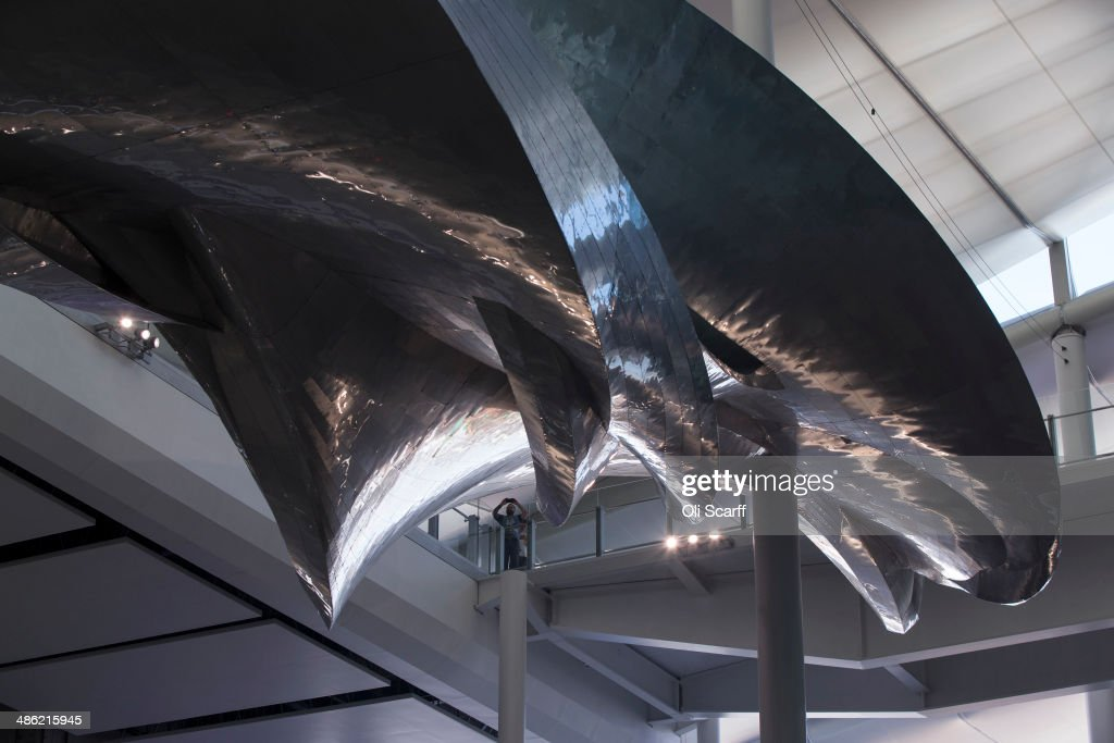British artist Richard Wilson's new artwork 'Slipstream' is displayed in Terminal 2 of Heathrow airport on April 23, 2014 in London, England. The aluminum artwork 'Slipstream' which is suspended 18 meters above the ground, weighs 77 tonnes and is 78 meters in length and is inspired by the flight path of a stunt plane. The rebuilding of Heathrow's Terminal 2 has taken five years at a cost of 2.5 billion GBP and will officially open to the public on June 23, 2014.