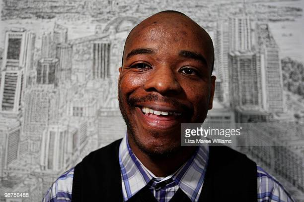 British artist Stephen Wiltshire sits with his detailed sketch of the Sydney cityscape during a press conference at Customs House on April 30 2010 in...