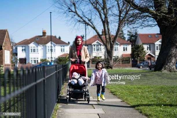 british asian mother and young children enjoying exercise - season 3 stock pictures, royalty-free photos & images