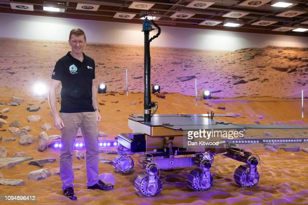 British Astronaut Tim Peake poses beside a working prototype of the ExoMars rover after it's naming ceremony at Airbus Defence Space facility on...