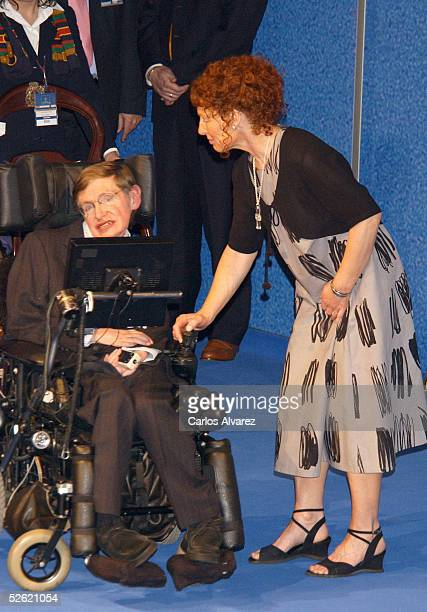 British astrophysicist Stephen Hawking and an unidentified person attend his conference at the Prince of Asturias Auditorium on April 12 2005 in...