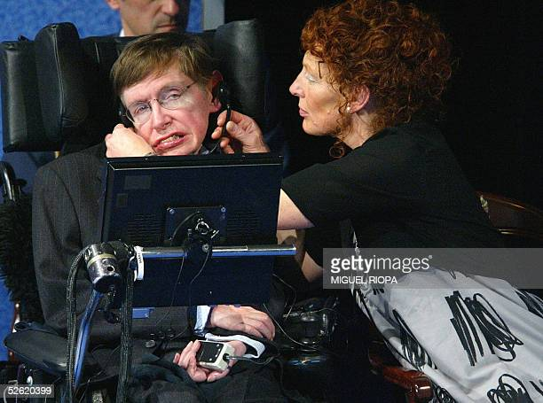 British astrophysicist Stephen Hawking's wife Elaine adjusts the earphones to her husband after his conference to open the XXV Prince of Asturias...