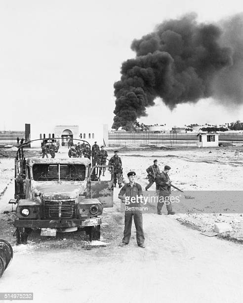 British at Port Said Port Said Egypt British troops advance through Port Said as oil installations burn during the AngloFrench invasion of the Suez...