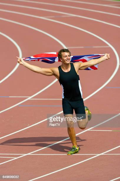 british athlete celebrates with gb flag. - lap of honour stock pictures, royalty-free photos & images