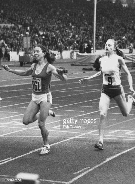 British athlete Christine Benning celebrates victory ahead of Norwegian athlete Grete Waitz as they reach the finish line of the Women's 1500-metre...