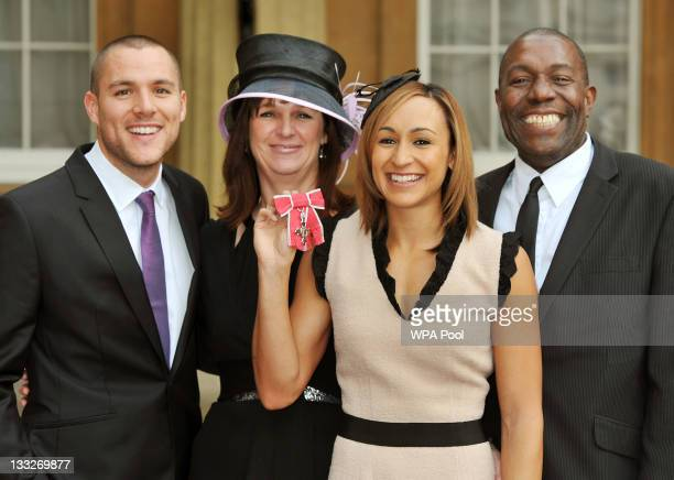 British athlete Jessica Ennis holds her MBE alongside her Fiancee Andy Hill and parents Alison and Vinny after it was presented to her by Prince...