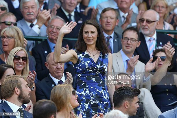 British athlete Jo Pavey stands and waves in the royal box on centre court before the start of the men's singles third round match between...