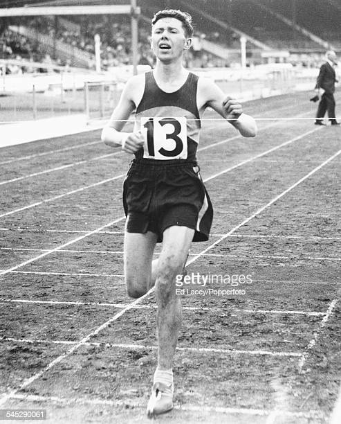 British athlete Ken Norris crosses the finish line to win the six mile race at the Amateur Athletic Association Championships White City London July...