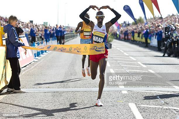 British athlete Mo Farah does his 'mobot' celebration as he wins the men's elite race in the Great North Run halfmarathon in South Shields north east...