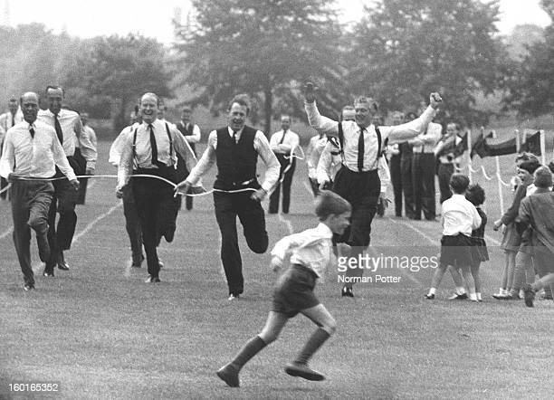 British athlete Roger Bannister coming second in the father's race at his son's school sports day 1965