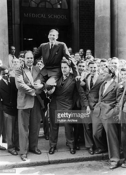 British athlete Roger Bannister is chaired by fellow students at St Mary's Hospital School on 7th May 1954 the day after becoming the first person to...