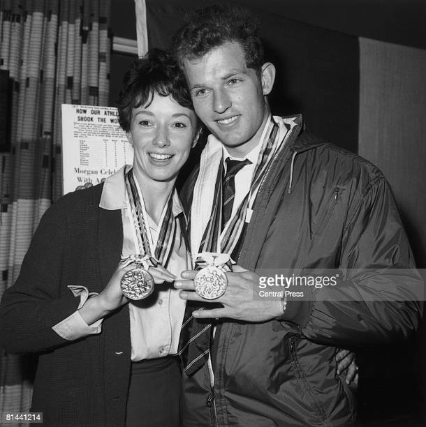 British athletes Ann Packer and her fiance Robbie Brightwell with their medals at London Airport on their return from the Tokyo Olympics 29th October...