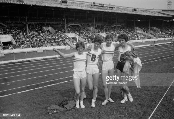 British athletes from left Madeleine Cobb Daphne Arden Mary Rand and Dorothy Hyman pictured together after setting a new world record time in the...