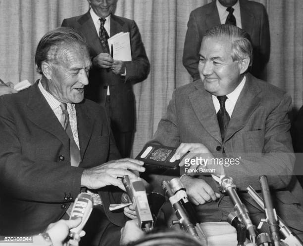 British author and lecturer Denis Hills arrives back at Heathrow Airport UK and is handed his British passport by Foreign Secretary James Callaghan...