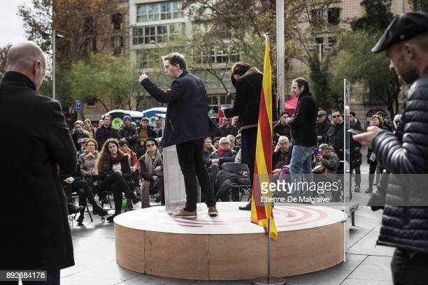 British author and political activist Owen Jones delivers a speech at a street meeting for En Comu Podem party on University square on December 14...