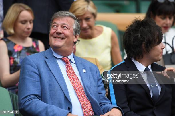 British author and presenter Stephen Fry and his husband Elliott Spencer sit in the royal box to watch Germany's Angelique Kerber play against US...