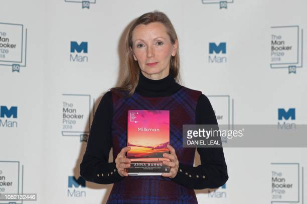 British author Anna Burns holds her book 'Milkman' during a photocall at the Royal Festival Hall in London on October 14 ahead of Tuesday's...