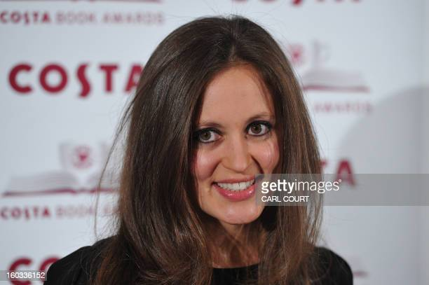 British author Francesca Segal writer of 'The Innocents' poses for photographers as she arrives for the 2012 Costa Book Awards in London on January...