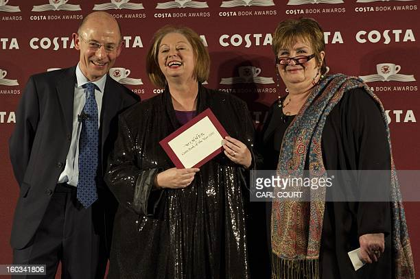 British author Hilary Mantel laughs as she poses with Costa Managing Director Chris Rogers and journalist Dame Jenni Murray after winning the Costa...