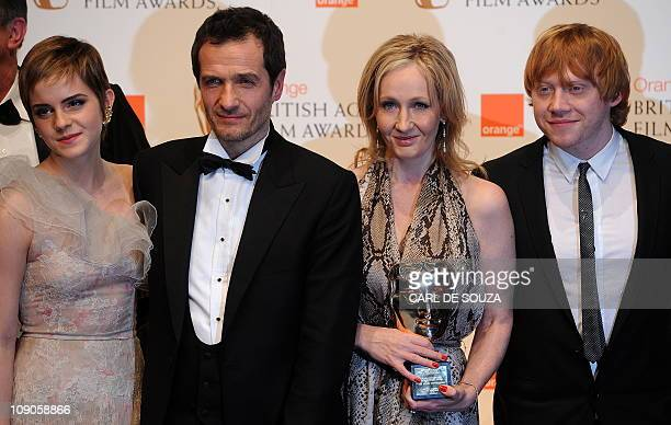 British author JK Rowling and producer David Hayman pose for photographers with British actress Emma Watson and British actor Rupert Grint after...