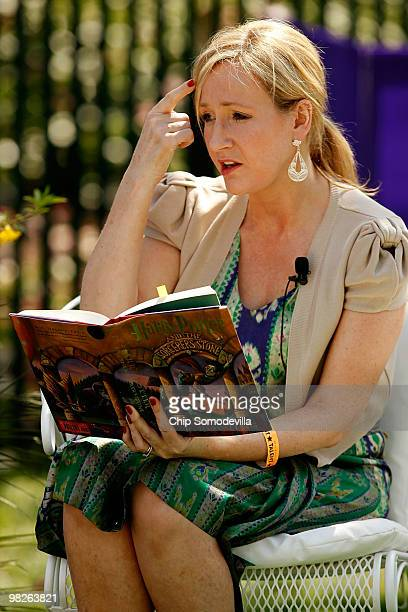 British author JK Rowling creator of the Harry Potter fantasy series points to the place on her forehead where her title character has a scar while...