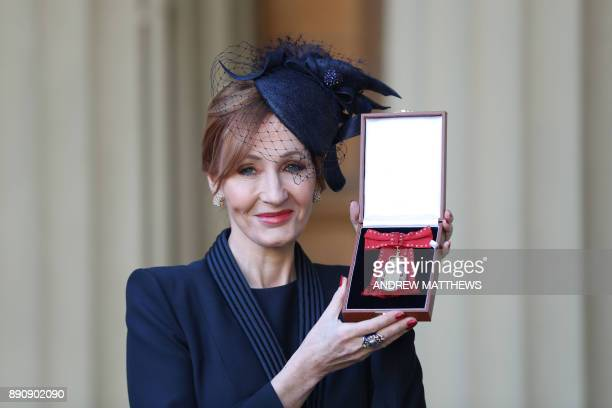 British author JK Rowling poses with her medal after being made a Companion of Honour for services to literature and philanthropy by the Britain's...