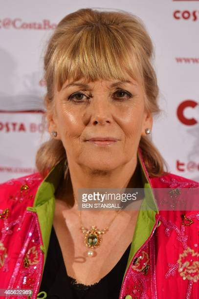 British author Kate Atkinson poses for photographs as she arrives for the 2013 Costa Book Awards in London on January 28 2014 The Costa Book Awards...