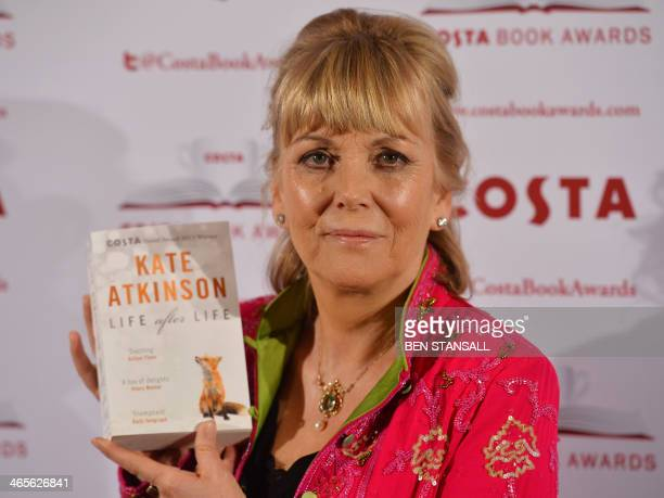 British author Kate Atkinson poses with her Novel Award winning book 'Life after Life' as she arrives for the 2013 Costa Book Awards in London on...