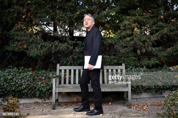British author Kazuo Ishiguro walks after holding a press conference in London on October 5 2017 after being awarded the Nobel Prize for Literature...