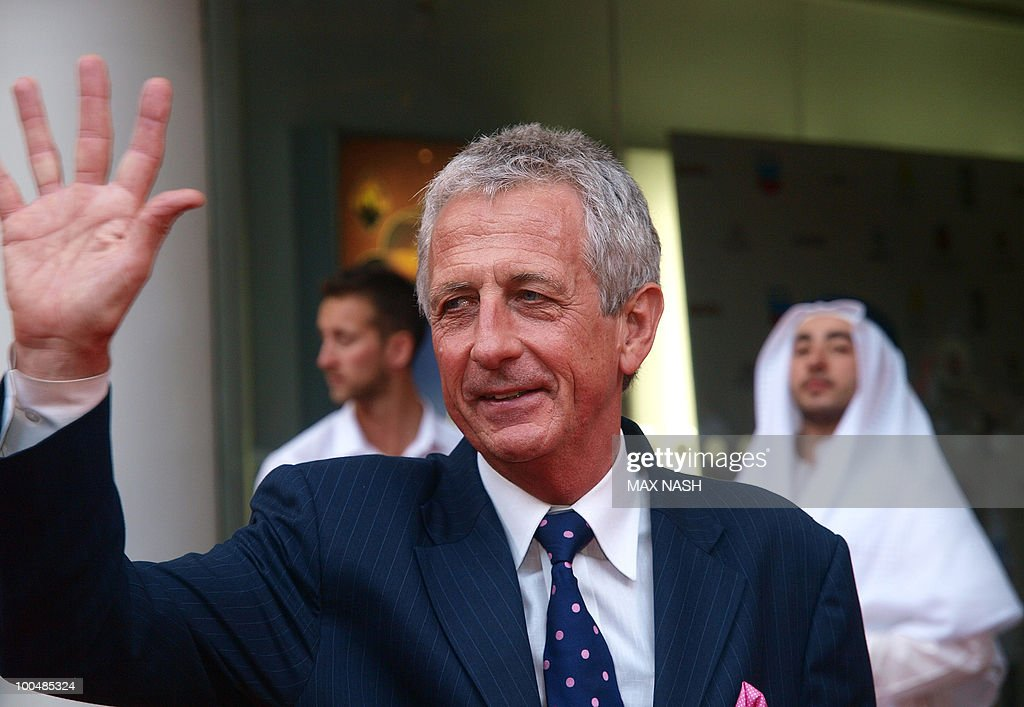 British author Robert Lacey waves as he arrives to attend the Royal Premiere of Arabia 3D in London's South Bank, on May 24, 2010. AFP Photo/MAX