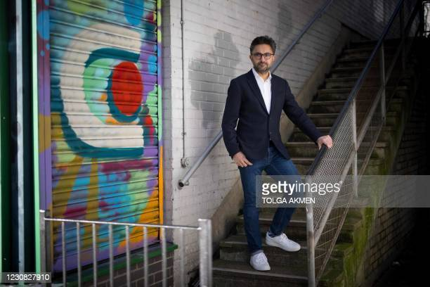 British author Sathnam Sanghera poses for a photograph in Hampstead, north London on January 25, 2021. - The statue of Robert Clive outside the...