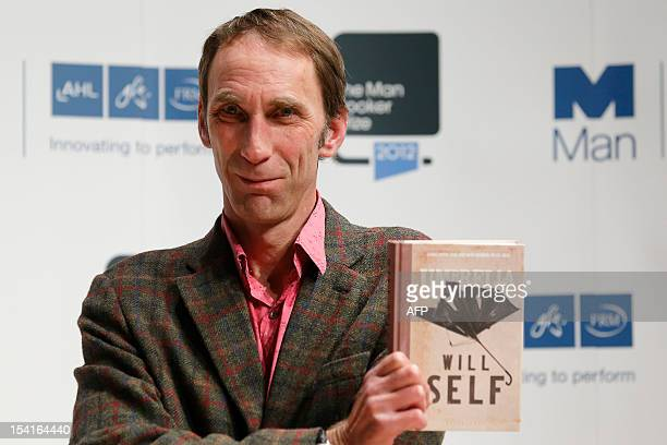 British author Will Self holding his book Umbrella for which he is shortlisted for the Man Booker 2012 literary prize poses during a photocall in...