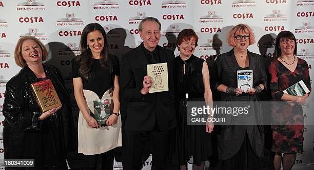 British authors Hilary Mantel Francesca Segal Mary M Talbot and Bryan Talbot Sally Gardner and Kathleen Jamie pose for photographers as they arrive...
