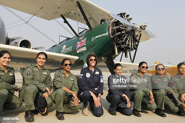 British aviator Tracey Curtis Taylor with Indian women pilots after her landing at Hindon Air Force Station for a stopover on November 24 2015 in...