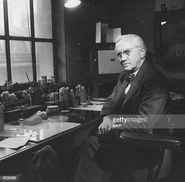 British bacteriologist and Nobel laureate Sir Alexander Fleming in his laboratory at the WrightFleming Institute St Mary's Hospital Paddington...
