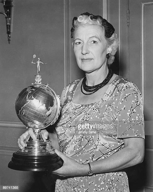 British badminton player Betty Uber at the Charing Cross Hotel London with the new Uber Cup trophy 4th July 1956 The tournament also known as the...