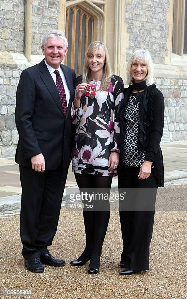 British Badminton player Donna Kellogg with her parents Neil and Sharon who was made a Member of the British Empire after an Investiture ceremony at...