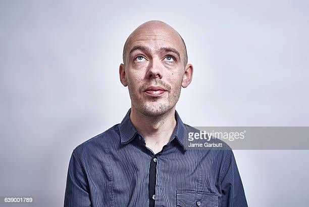 british bald male looking up - hair loss stock pictures, royalty-free photos & images