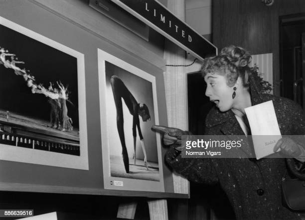 British ballerina and choreographer Gillian Lynne is fascinated by an image of herself at a photography exhibition in Kingsway London 5th November...