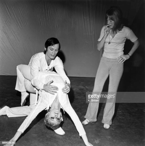 British ballerina and choreographer Gillian Lynne watches dancers Terence James and Elaine McDonald during a dress rehearsal for the Scottish Theatre...