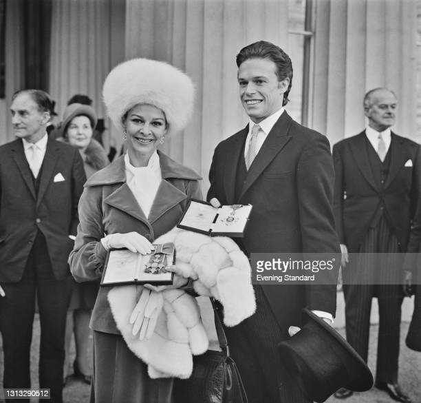 British ballet dancers Antoinette Sibley and Anthony Dowell during their investiture at Buckingham Palace in London, UK, 27th November 1973. They...
