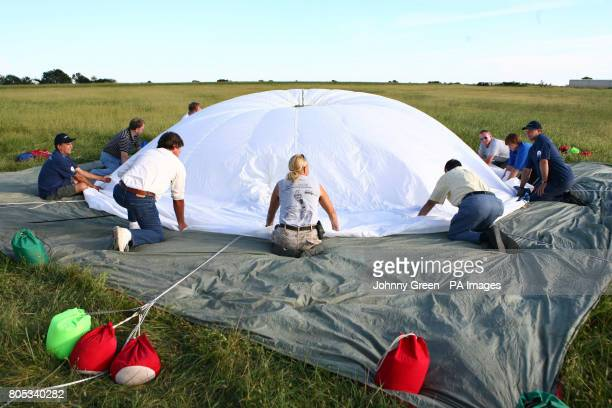 British balloonist and explorer David HemplemanAdams is joined by his support team and local townsfolk as they inhale the tiny helium balloon the CMC...