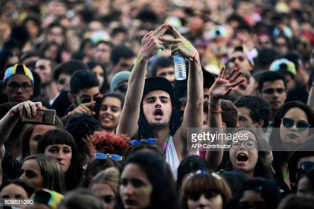 British band AltJ fans attend their concert at the 11th Alive Festival in Oeiras near Lisbon on July 6 2017 / AFP PHOTO / PATRICIA DE MELO MOREIRA
