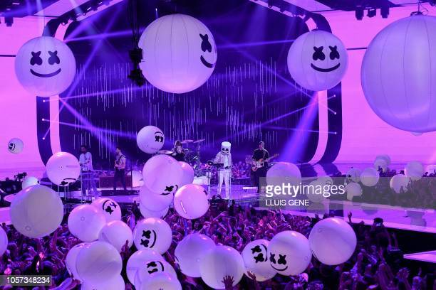 TOPSHOT British band Bastille and US DJproducer Marshmello perform during the MTV Europe Music Awards at the Bizkaia Arena in the northern Spanish...