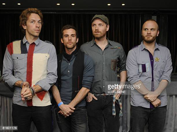British band Coldplay Chris Martin Will Champion Jon Buckland and Guy Berryman pose for photographers before a press conference in Barcelona on June...